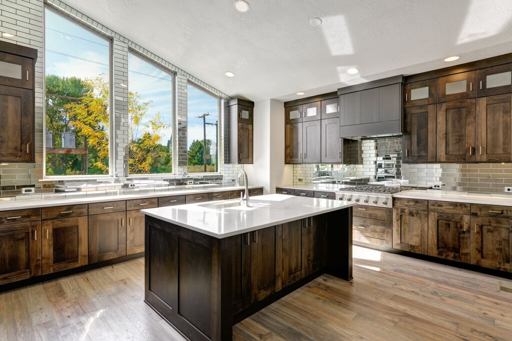 The Wayne is now available! The kitchen features large windows and a unique backsplash.