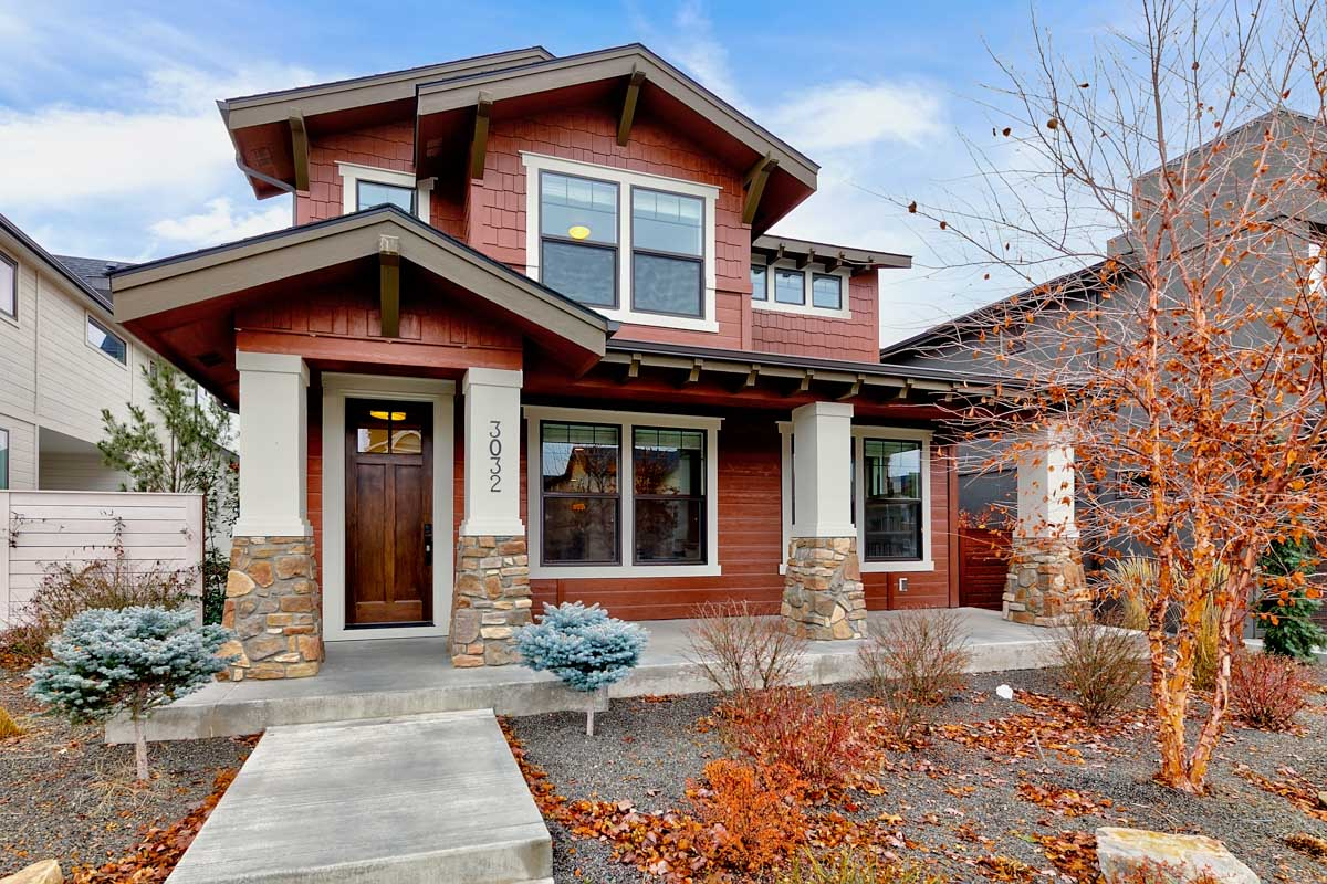 photo of the exterior of a craftsman style home, with front porch.